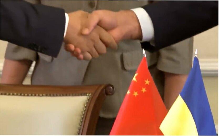 Отношения Украины с Китаем, Дмитрий Ефремов, Юрий Романенко