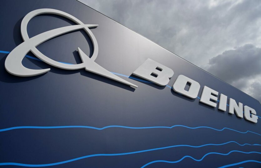 Signage for Boeing is seen on a trade pavilion at Farnborough International Airshow in Farnborough, Britain