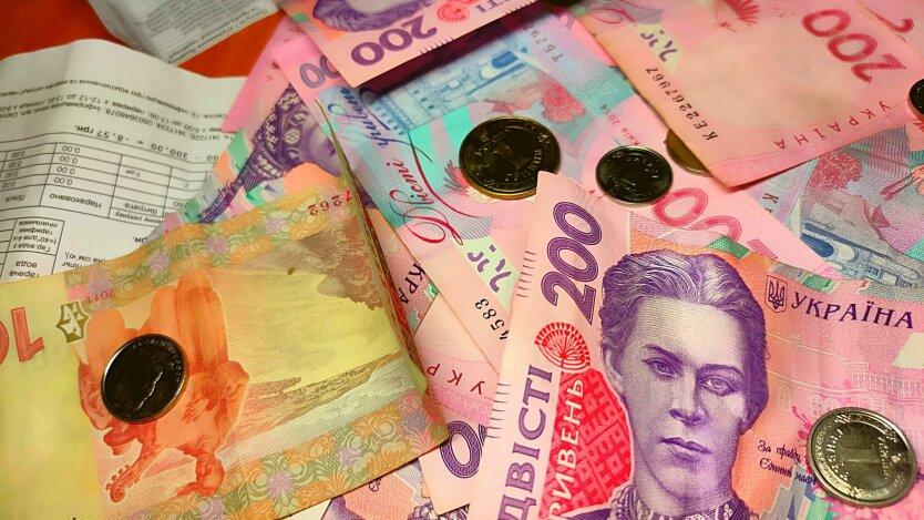 Деньги и платежки за коммунальные платежи по ЖКХ в Украине