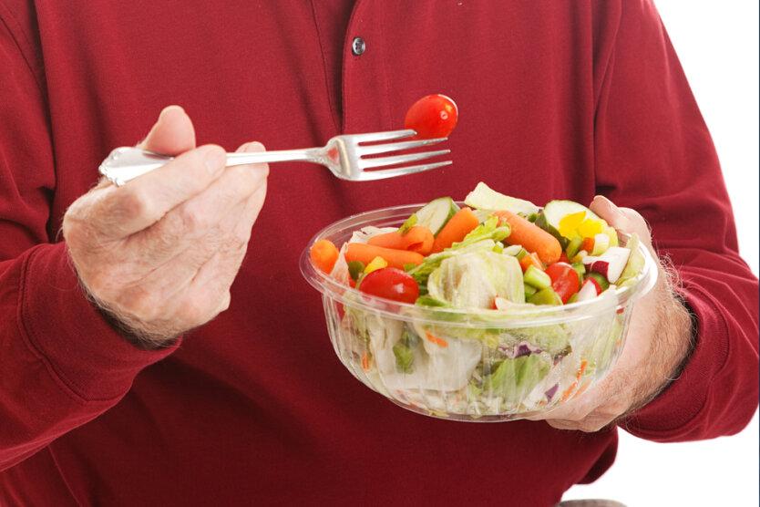 Senior Man Eats Salad — Closeup