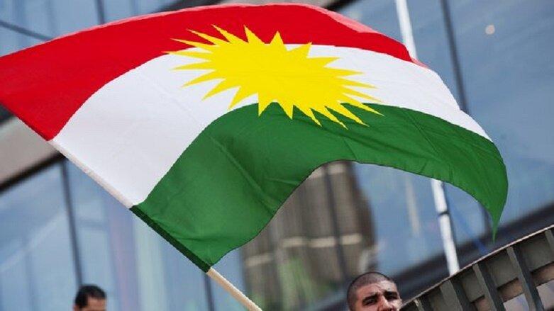 A man holds the Kurdish flag on Septembe