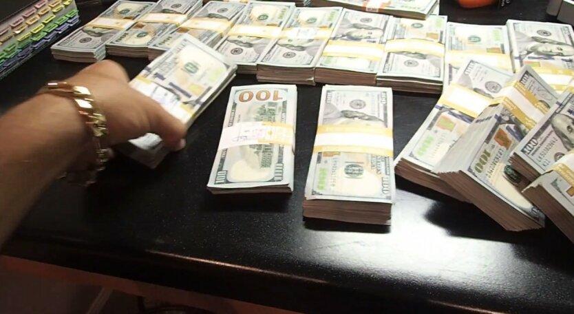 Обмен валюты в Украине,Девальвация гривны,Прогноз на курс валют в Украине