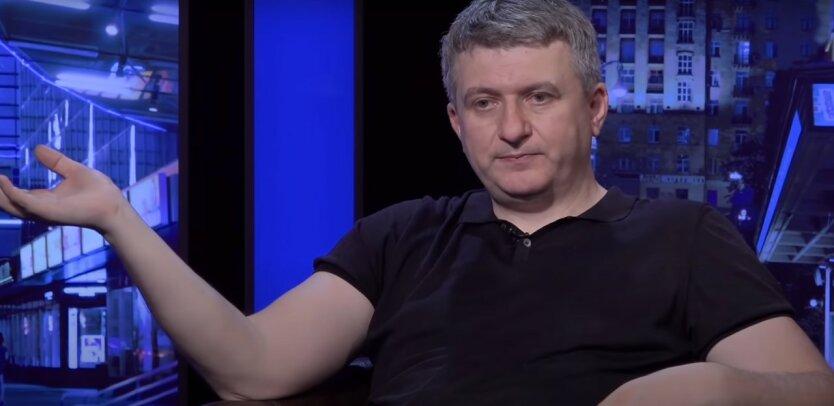 Юрий Романенко,Михаил Саакашвили,налог на выведенный капитал,эмиссия гривны